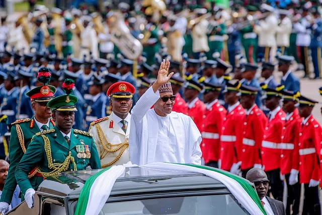 Mixed reactions as President Buhari vows to rebuild Nigeria, renames stadium after MKO