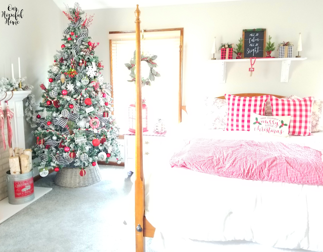 farmhouse Christmas bedroom flocked tree red quilt birch logs