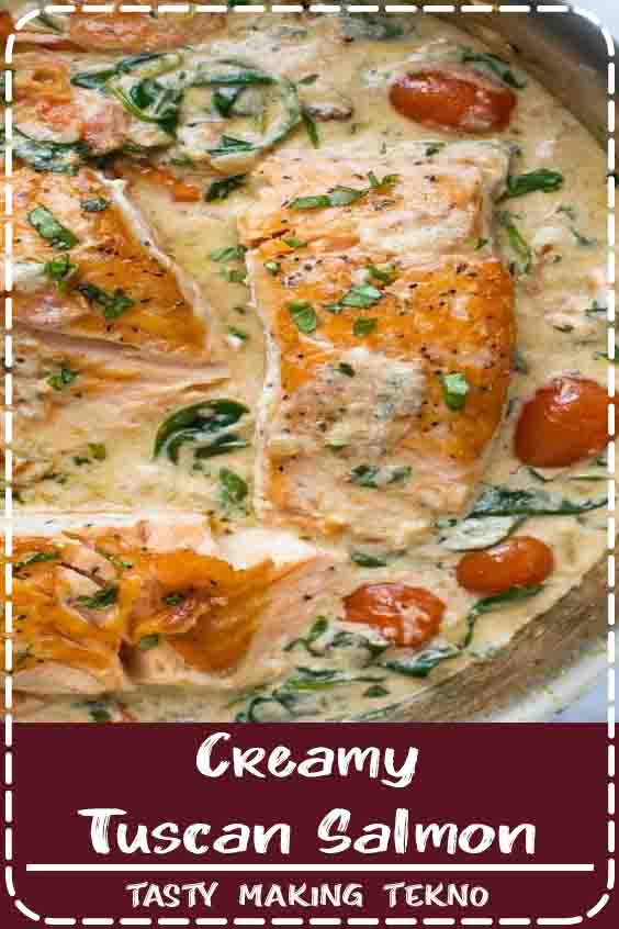 The BEST Pan Seared Creamy Tuscan Salmon Recipe you'll ever make. Crispy tender Salmon served with a creamy (dairy free) tuscan garlic white wine sauce that will make you swoon. Guaranteed to be new dinner favorite!