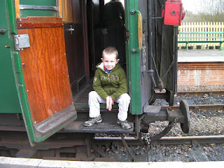 open door of steam train passenger carriage footplate