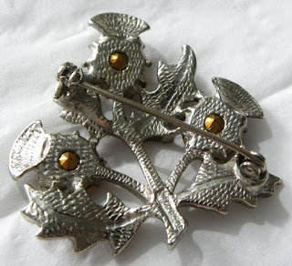 Back of a Scottish brooch stamped Miracle
