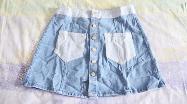 Details on the denim button-front patchwork light waist rose patch embroidered a-line mini skirt from Zaful.