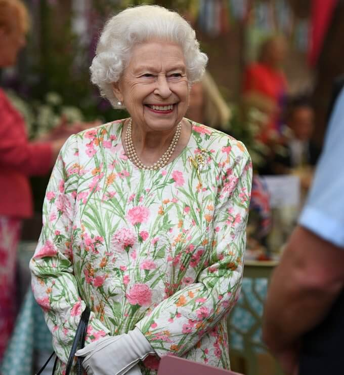 Queen in a floral outfit, Kate  in white coat dress, Carrie Johnson, wore a dressby Vampire's Wife, Jill Biden in trench coat