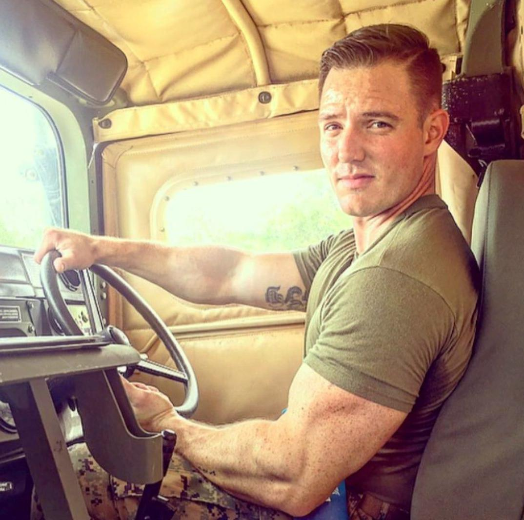 beefy-muscle-soldier-on-duty-driving-military-truck-huge-biceps-bangable-smirk