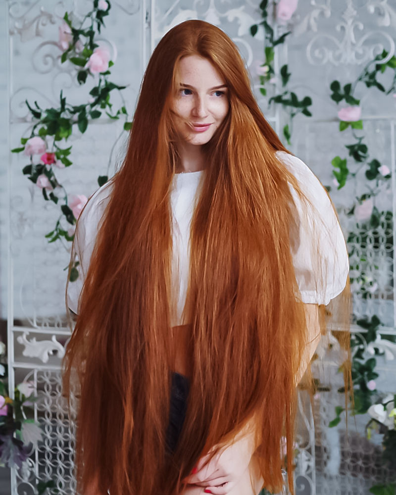a portrait of a woman in the studio with long ginger hair