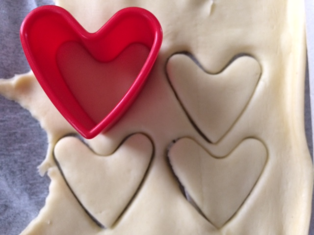 Heart cutter cutting pastry