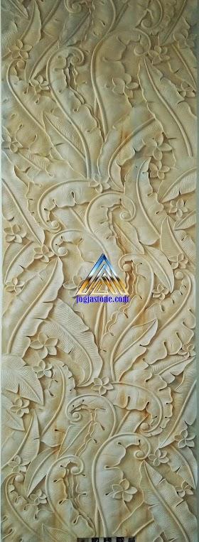 ukiran relief daun pisang dari batu alam putih
