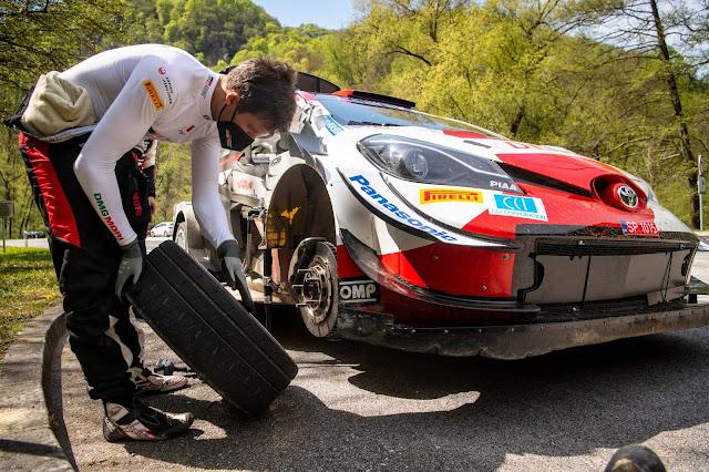 Sebastien Ogier repairing his toyota Yaris rally car
