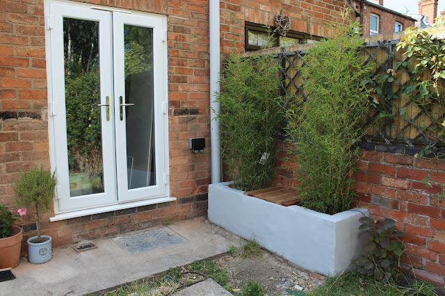 brick planter with wooden seat
