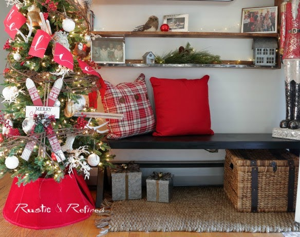 Christmas Inspiration in the entryway using rustic touches and pops of red.
