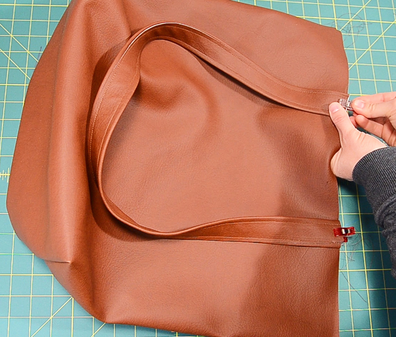 attach straps to leather bag