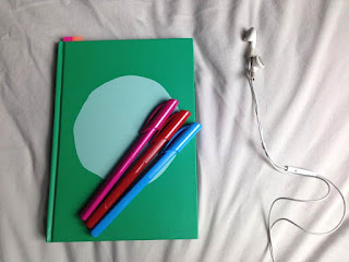 notebook, stationary, ear phones, iphone, travel, holiday