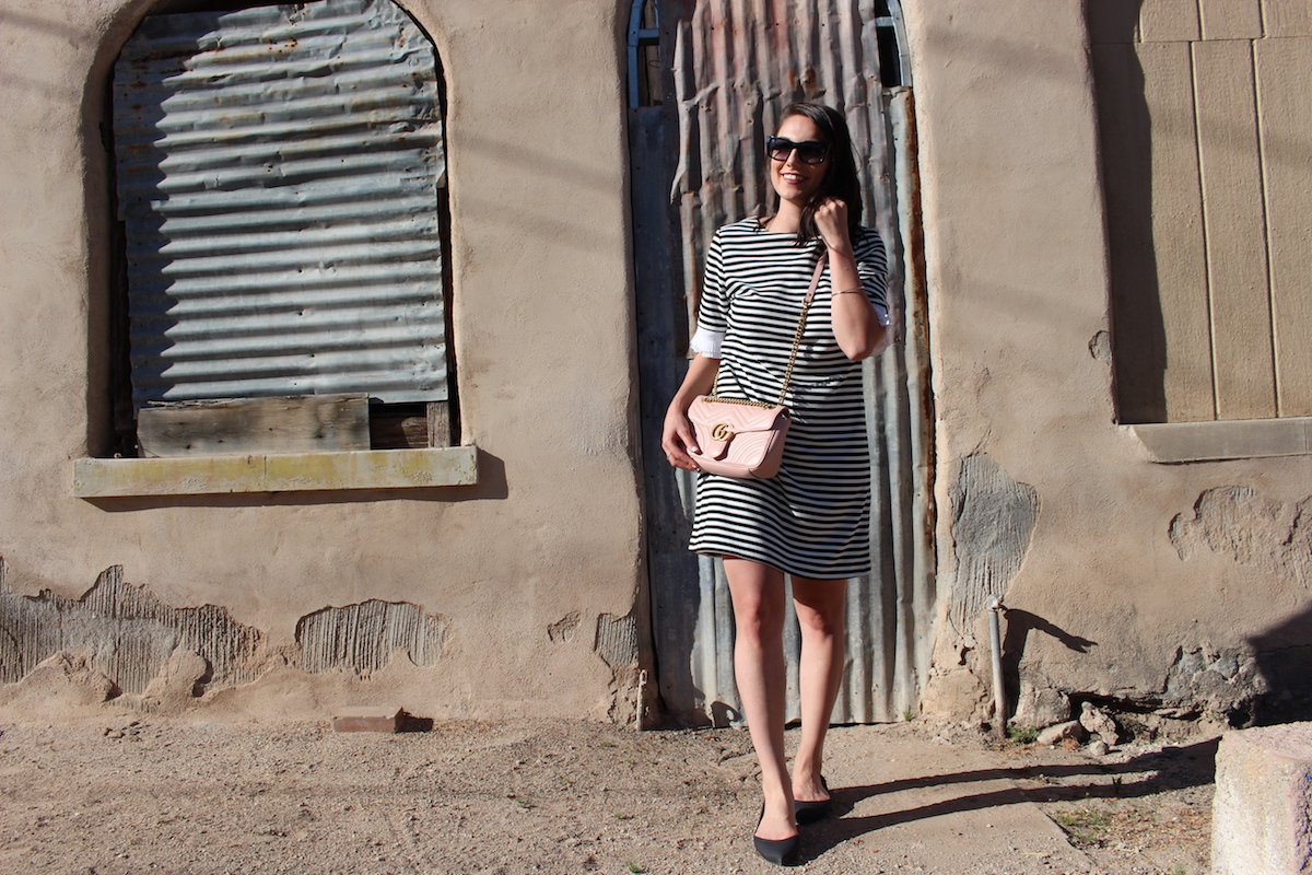 Looking through Barrio Viejo while wearing a black and white striped dress with my Gucci bag.