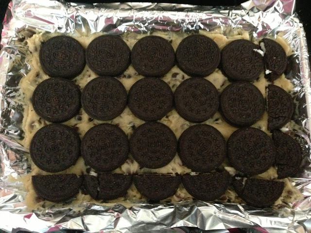 oreo layer on top of cookie dough in slutty chocolate brownie recipe