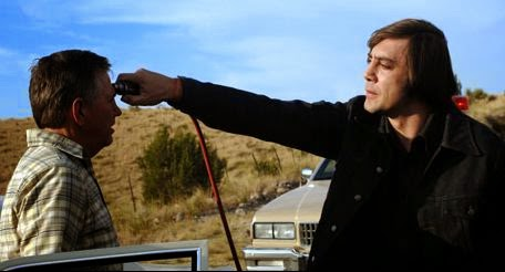 Javier Bardem as Anton Chigurh killing his victim using a cattle gun, disguised as a police officer, in No Country for Old Men (2007), Directed by Joel and Ethan Coen