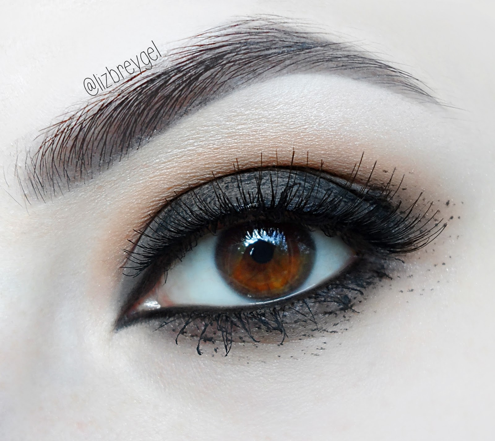 a close up of brown grunge smokey eye makeup