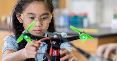 Asian girl building STEM toy