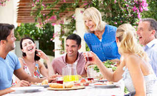 Photo of a Family Dining Al Fresco