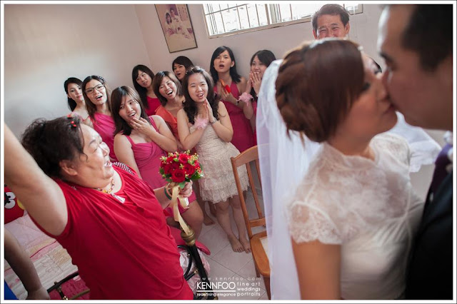 bride kissing groom, bride maids impressed
