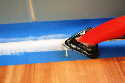 Use smoothing tool for consistent caulk with less mess