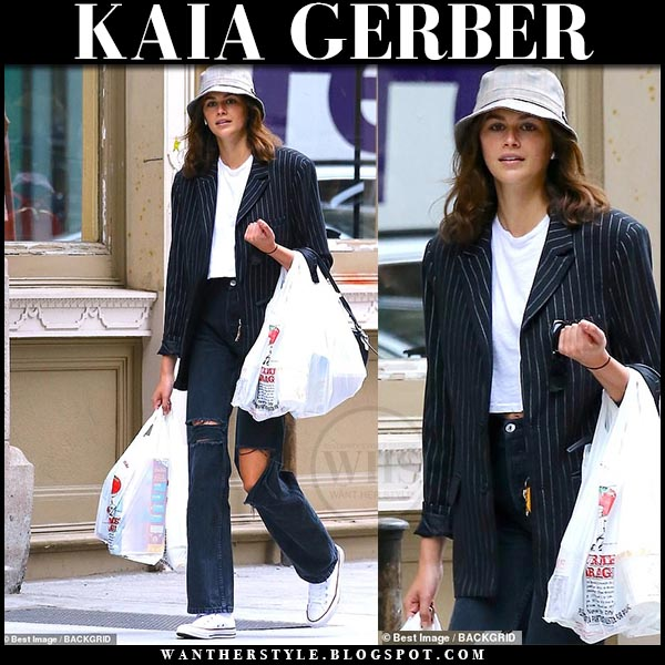 7221e48ca0a Kaia Gerber in black pinstripe blazer and black ripped loose jeans. Casual  off duty model