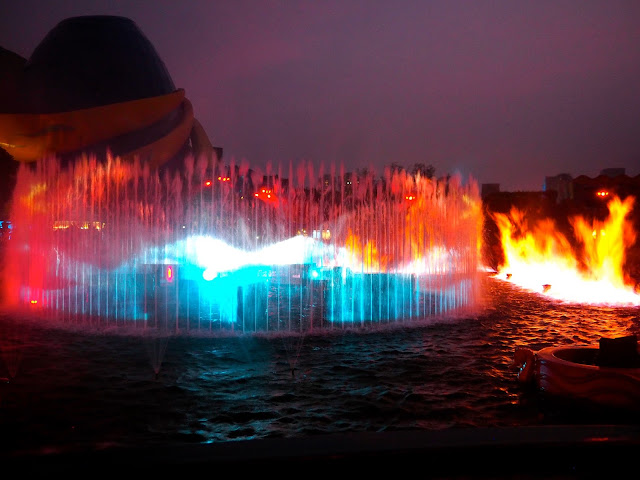 Fountains and flames on the lagoon in Symbio show, Ocean Park