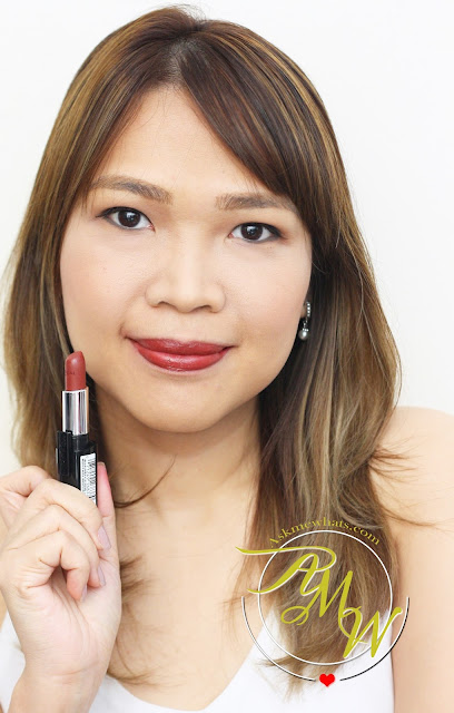 a photo of AskMewhats wearing L'Oreal Infallible 10H LongWear Lipstick Resilient Raisin