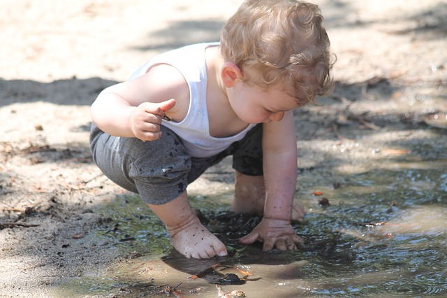 Child Playing in a Mud Puddle