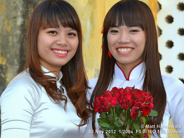 close up, people, groupshot, double street portrait, Vietnam, Hanoi, Vietnamese women, white áo dài, silk, roses