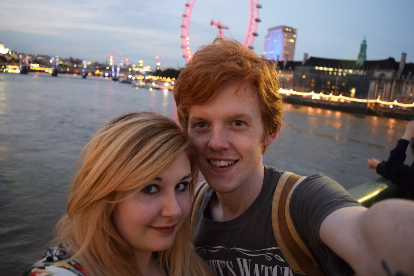 Sean and Grace standing in front of the London Eye