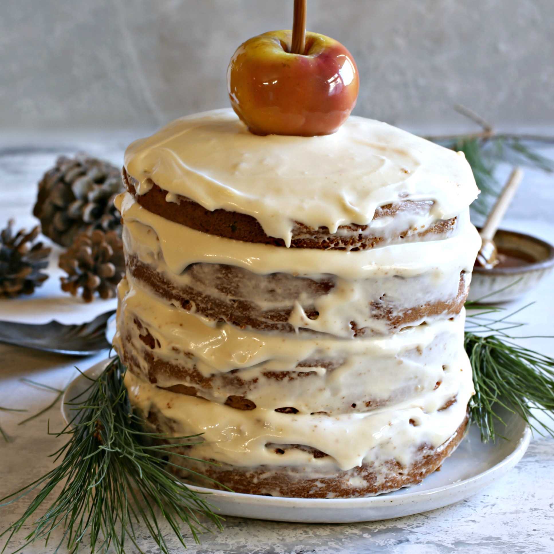 Recipe for a layered honey gingerbread cake, filled with apples and honey cream cheese frosting.
