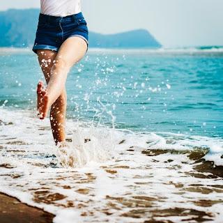 woman walking in sea beach