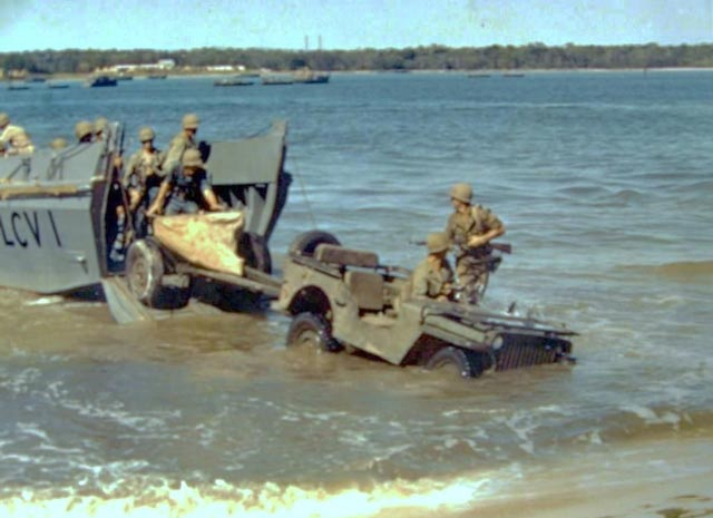 Landing Craft unloading a Jeep during World War II worldwartwofilminspector.com