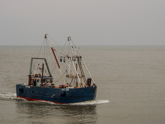 Photo of another fishing boat heading for home