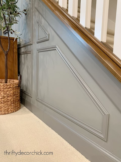 Panel molding under stairs
