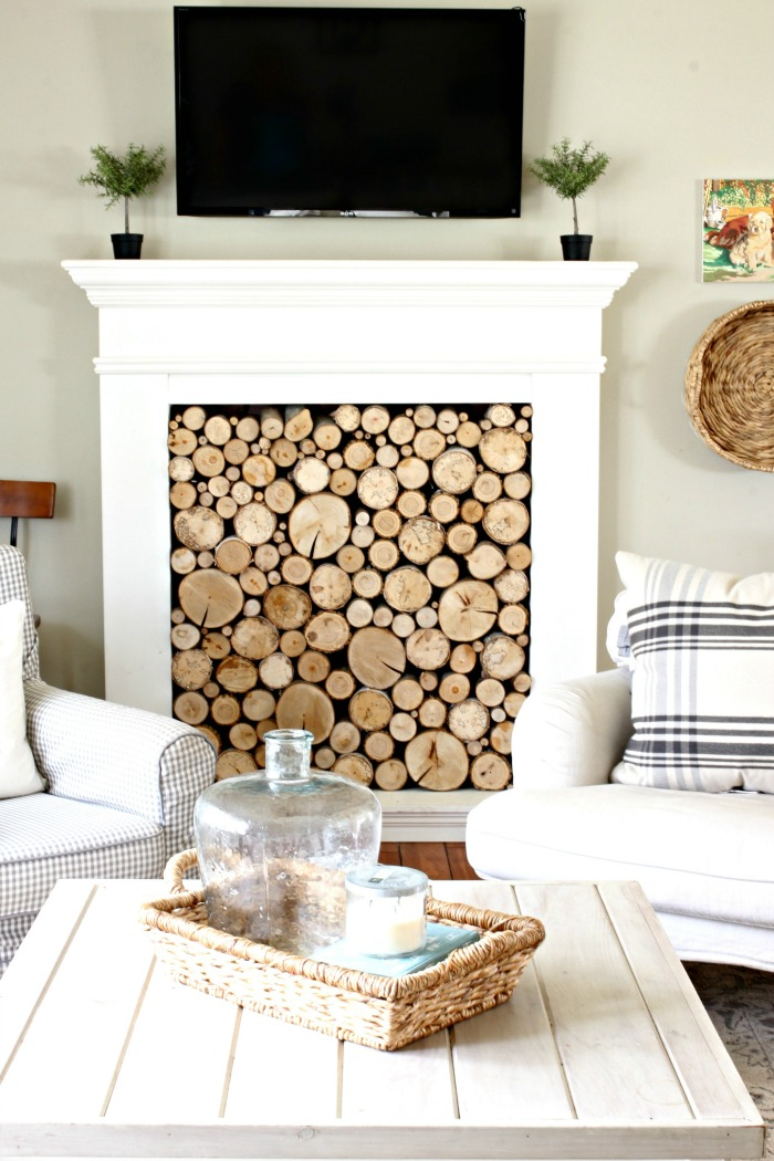 DIY faux fireplace with tv mounted over the fireplace - www.goldenboysandme.com