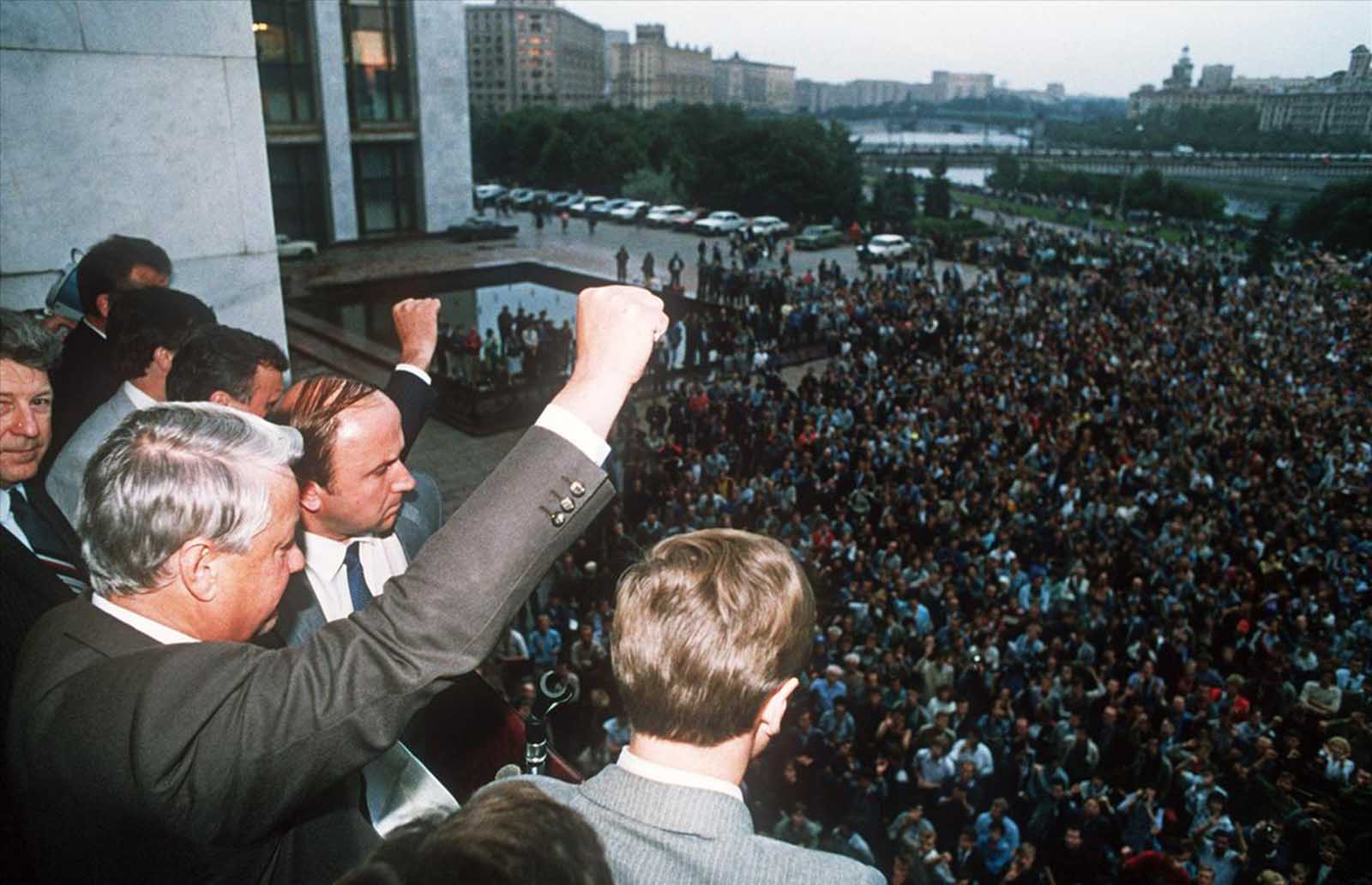 A defiant Russian President Boris Yeltsin (left) raises a fist to his supporters from the Russian Federation building in Moscow on August 19, 1991, calling on them to hold a general strike and to resist the pro-communist coup against Soviet President Gorbachev.