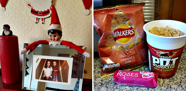 The Christmas elf on the shelf and a pot noodle and packet of crisps