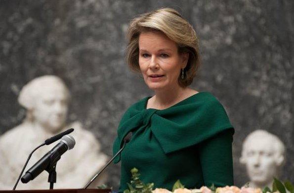 Queen Mathilde wore a green dress by NATAN. Queen Elisabethand Queen Fabiola Honorary Member of Belgian Royal Academy