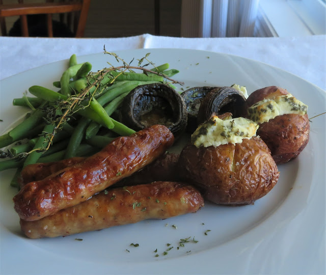 Roasted Sausages with Goat's Cheese Stuffed Baby Potatoes