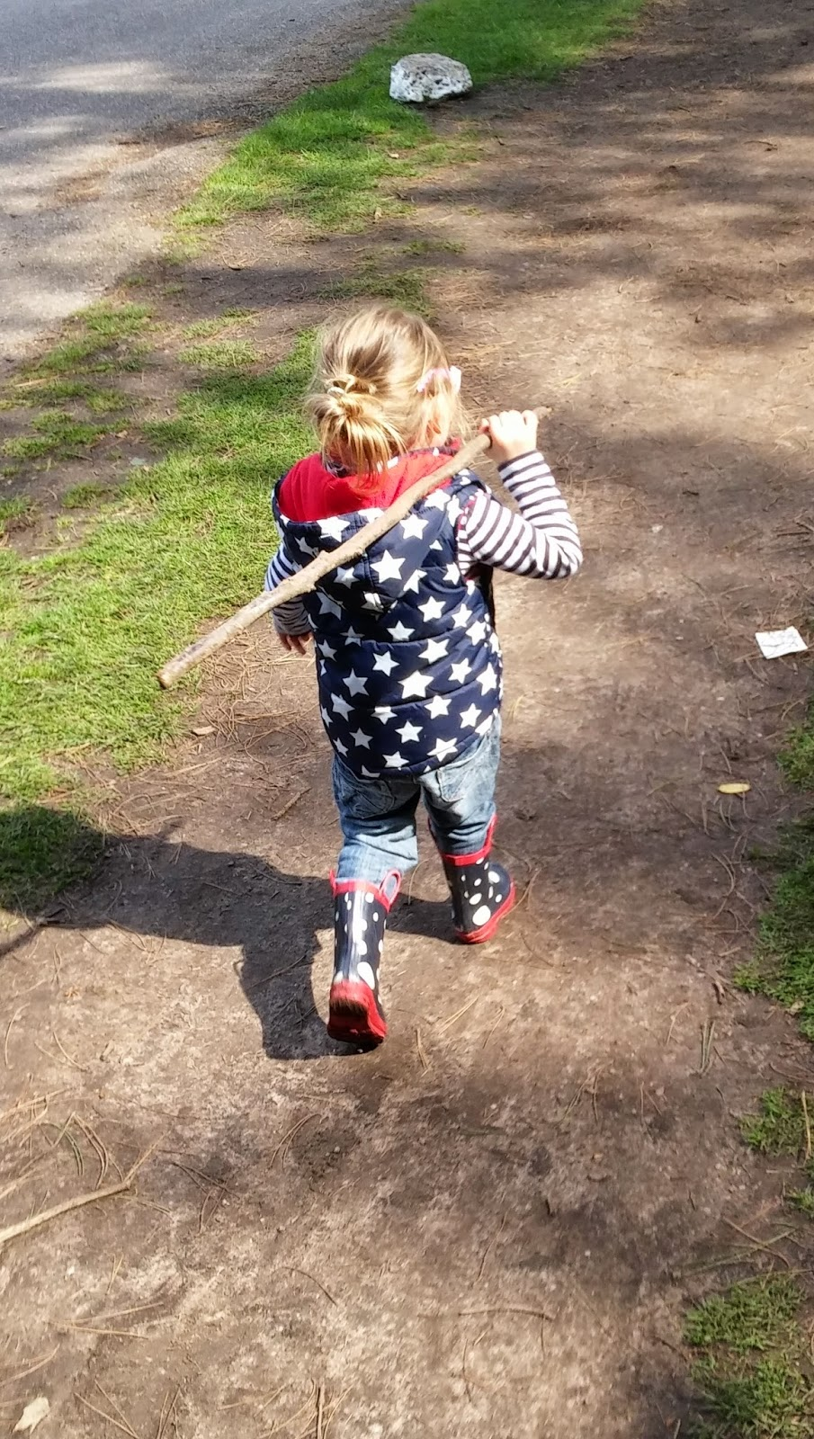 child carrying stick