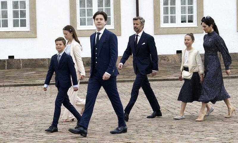 Crown Princess Mary wore IRIS & INK Alison polka-dot satin midi dress. Princess Isabella wore an ivory blazer suit from MaxMara