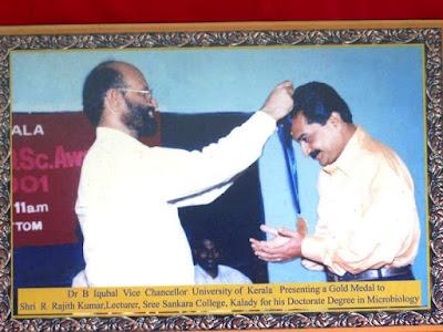 Dr Rajith Kumar Receiving an Award