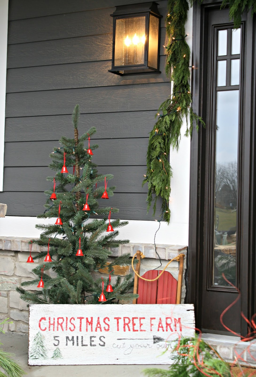 Christmas porch with tree and sign