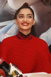 Sonam Kapoor Promotes Nirja in Delhi in Dark Red Designer Dress