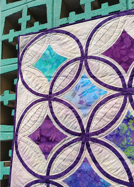 Moonrise quilt by Slice of Pi Quilts using Lavendula fabrics by Island Batik