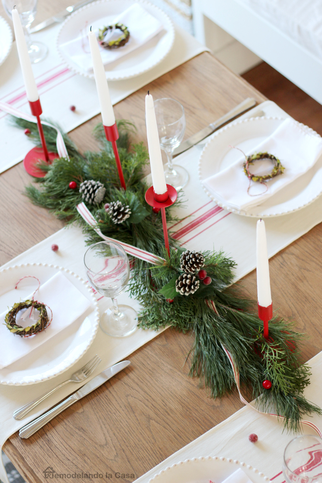 pine cone, pine clippings, red candle stick and candles create a stunning holiday centerpiece.