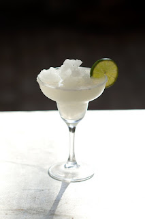 Margarita glass and drink with slice of lime