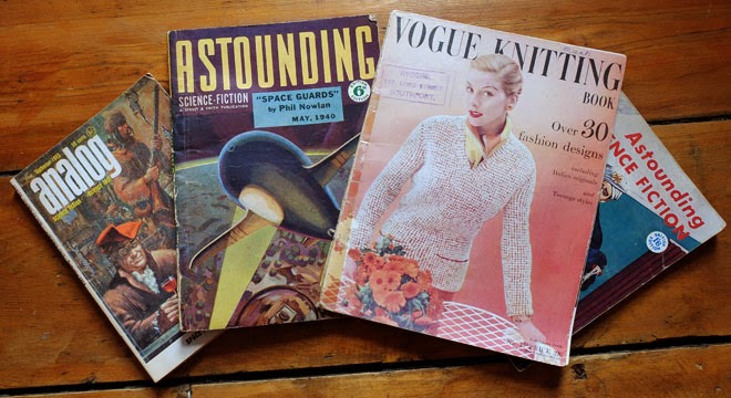 Four vintage magazines: one copy of Vogue Knitting, and three of Astounding Science Fiction