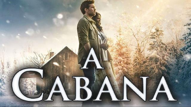 Duas pessoas adultas (Um homem é uma mulher) em frente de uma cabana e o título do filme